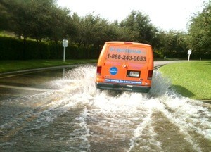 911 Restoration Birmingham Van Driving Through Flooded Street
