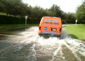 911 Restoration Birmingham Van Driving Through Flooded Street