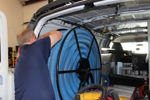 Flood Damage Restoration Technician Prepping Suction Hoses