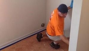 Water Damage Technician Doing Final Checks After A Flood Cleanup