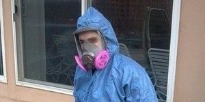 Mold and Water Damage Restoration Technician With Tools