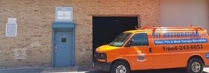 Water and Mold Damage Restoration Van Parked Outside Headquarters