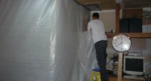 Technician Removing Mold With A Vapor Barrier